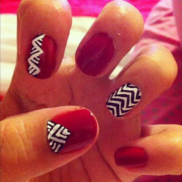 Red with black and white striped nails